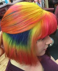 Orange rainbow dyed hair color with bangs @jules_does_hair tye-dye