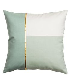 Dusky green. Cushion cover in cotton twill with a color-block front section with a metallic printed detail, solid color back section, and a concealed zip.