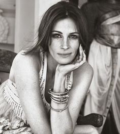 Julia Roberts - because she's funny and confident...and her laugh....HELLO!?