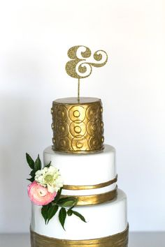 Ampersand cake topper. Um, yes please! I wonder if we could do cake at the Chandelier Bar at the Cosmo...