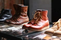 A display of Red Wing shoes in Amsterdam, showcasing low and high top boots.