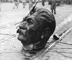 A disembodied statue of Joseph Stalin's head on the streets of Budapest during the Hungarian Revolution, 1956