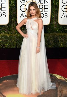 1.10.16 Lily James in Marchesa w/ Harry Winston jewelry at Golden Globe Awards