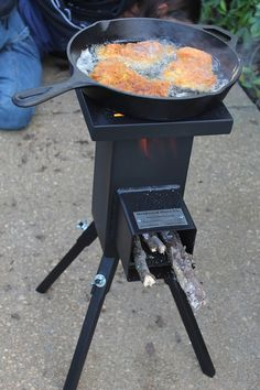 A nice little variation on the rocket stove concept. This would be good for camping. - Living Prepared: Survival Cooking