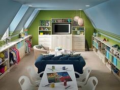 I really like the idea of setting the bonus room/boys' room up as a lounge.  This is a really cute execution.