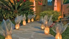 Screen-Wrapped Luminaries:  Wrap economical canning jars in window screen fabric for luminaries that transform from airy sculptures during the day to warm, glowing lights at night.