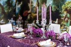 """<p>Who said dark hues are only reserved for winter and fall tablescapes? Event designer Ron Wendt used a rich brocade tablecloth and deep purple tones, with gold tableware from <a href=""""http://l-objet.com/"""" target=""""_blank"""">L'Objet</a> as a luxe compliment to the painted pastoral backdrop.</p><p>Via <a href=""""http://www.ronwendtdesign.com/"""" target=""""_blank"""">Ron Wendt Designs</a>.</p>"""