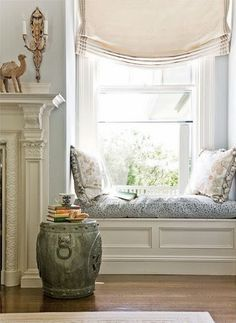 Window Seat- cushion and pillows with small garden seat as table. Simple shades or curtains.