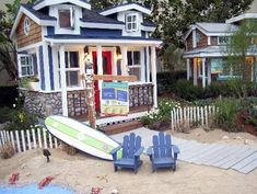 Playhouse Designs and Ideas: Big Dreams for Small Houses: A stone facade and white trim accent architectural details of this California-style beach cottage playhouse.