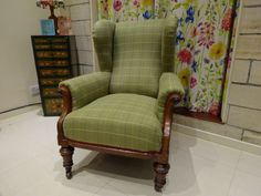 Plaid reupholstered armchair by Kirsty Lockwood Furnishings