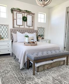 @down_mulberry_lane has the most beautiful bedroom! We Love our Distressed Wood Chandelier styled in this space. #woodchandelier #distressed wood #farmhouselighting #farmhousebedroom