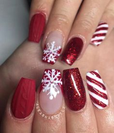 Gorgeous snowflake, candy cane, glitter, and red Christmas nails! #christmasnails #christmasnailart #christmasnaildesign #Christmas2018 #rednails