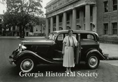 1933 photograph of a woman standing in front of a car. (Georgia Historical Society)