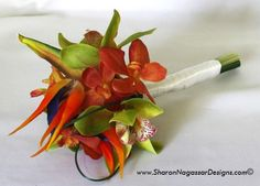 "Bridal bouquet - Orange/black bird of paradise, green cymbidium orchids, orange/coral vanda orchids and grasses Size: 7.5"" wide, 11"" tall  [Sharon Nagassar - $38.70]"