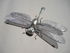 A beautiful bug upcycled from old cutlery and unwanted bits and pieces.
