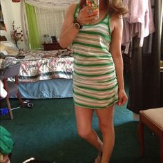 Green and white beach dress Cute mini dress ,perfect condition 100%cotton ,perfect for the beach size large but is more like small medium Caslon Dresses