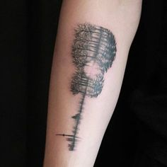 Double exposure guitar tattoo that includes the entire city of Toronto, trees, and a soundwave of his parents and sister saying 'I love you,' located on Shawn Mendes' right inner forearm.