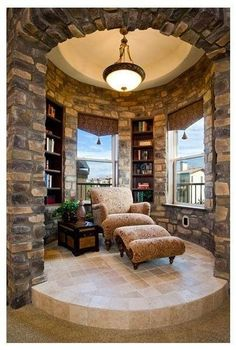 reading turret. I want one! Doesn't have to be stone, just a turret with shelves and comfy seating.