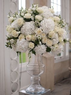 Statement arrangement of hydrangea, lissianthus and roses