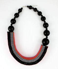 The Celeste asymmetrical woven beaded necklace in orange / pink