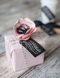 Diy Chalkboard Gift Tags!!! Bebe'!!! Sophisticated style of gift wrap in pink and black with trendy blackboard gift card, pink and whit string bow and pink paper flower with black and white glass inserts!!!