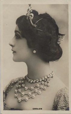 Italian opera singer, Lina Cavalieri, earlier in her career, wearing two belle epoque tiaras. One on the front of her head, and another over the back of it, though the wires keeping them in place show through.