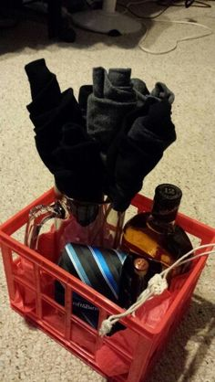 My boyfriends Valentine's Day gift this year! Beer mug, Johnny Walker Black and Red Label shooters, Sock bouquet, tie, and whiskey rocks.