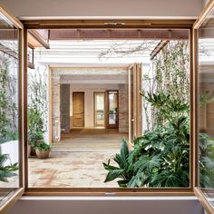 carles enrich intertwines patios with interiors for house in barcelona in a few years the planter will grow into a pergola mixing wisteria with vine and jasmine Common House Plants, Casa Patio, Internal Courtyard, House Design Photos, Design Moderne, Patio Table, Dining Table, Gazebo, Pergola
