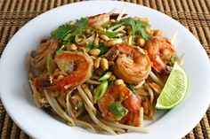 Pad Thai is a dish of stir fried rice noodles with egg, a sauce and various extras like shrimp, bean sprouts, peanuts and cilantro.