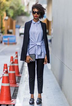 It's all about putting subtle twists on classics. Choose a light-blue tailored shirt with cutesy details like exaggerated sleeves, ruffles or bows. Then, layer stripes on stripes by matching it with a horizontally lined navy suit. Finish with leather loafers, a structured clutch and a slick of bold lippie for an 'I got this' vibe