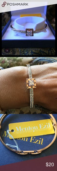 Menton Exil Rose Gold Jointed Bangle Gorgeous bangle with clasp that is adjustable by removing center piece.  Centerpiece is a riveted square fixed with a large sparkling crystal.  Bangle is pave with a double row of crystals.  Brand new with tags on.  Comes in box as shown.  💕🎀Make an offer or bundle for discount!!🎀💕  💋💋Amy Menton Ezil Jewelry Bracelets