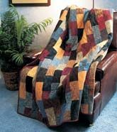 """""""Love of Quilting"""" staff designed this simple, cozy, masculine quilt. Set aside a stack of fat quarters and a weekend. Quilt size x Project rating: Easy. Man Cave Quilts, Man Quilt, Strip Quilts, Easy Quilts, Easy Quilt Patterns, Quilting Ideas, Flannel Quilts, Fat Quarter Quilt, King Size Quilt"""