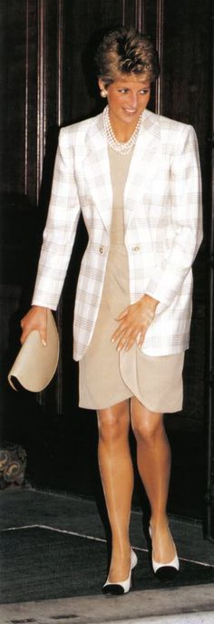 Princess Diana with her short permed hair ! Fashion world said she had a pair of the best pins in the world !