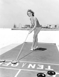 Cheryle Aurland playing shuffleboard