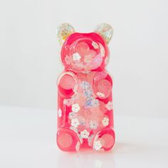 Gummi Bear Pop Art sculpture in shades of pink with glitter and sequins.