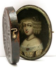 leather locket from the 17th century, with miniature portrait hand painted on copper. The locket comes with small transparent mica plates with different hair styles and clothes, so the lady can play dress up! #antique #locket