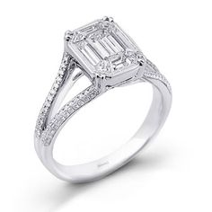 Style MR2019, 18K white gold engagement ring with .31ctw round white diamonds and a 1.00ctw mosaic center made up for 9 baguette-cut white diamonds, Simon G