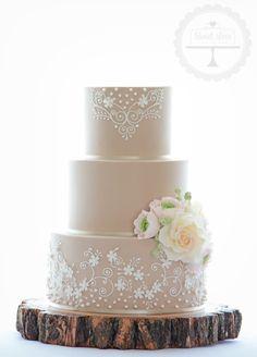 Rustic meets vintage wedding cake with sugar ranunculus, roses and berries