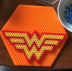 Perler WW Wonder Woman symbol logo pattern on hexagon pegboard