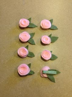 These cute DIY rose hair bows were made with felt. Roll a felt flower, add some leaves and attach to a hair clip with glue. #diy #sisterday #hairbows #babyhair