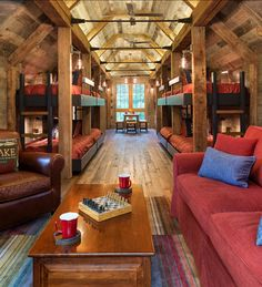 Bunk House with Rustic Interiors Bunk House. This place is perfect for extended family and friends. Bunk Beds With Stairs, Kids Bunk Beds, Cabin Bunk Beds, Loft Beds, Rustic Lake Houses, Haus Am See, Bunk Rooms, Loft Spaces, Rustic Interiors