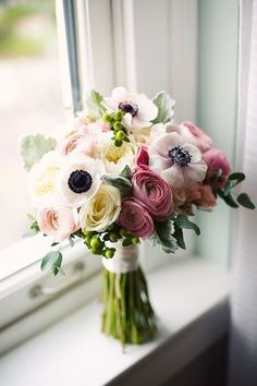 GORGEOUS. ranunculus, garden roses, black and white anemones, hypericum berries and dusty miller