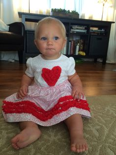 Jennifer made this dress for her adorable niece. She used the RUFFLED ROSETTE pattern...and LOVES her ruffler!
