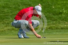 Professional Robert Karlson marks his ball at the European PGA Tournament Volvo Golf Champions Tournament action at Durban Country Club January 2014 South Africa Pga Tournament, Volvo, South Africa, Champion, January, Royalty Free Stock Photos, Action, Club, Country