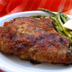 Pork chops are crumbed with Italian flavoured breadcrumbs and Parmesan cheese then baked for a delicious dinner.