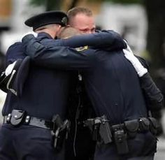 A picture contains 1000 words. Police officers weep in Newtown, CT. God Bless all those whose lives were forever changed because of one sick individual. And thank God for our police officers and first responders. Police Lives Matter, Police Life, Innocent Child, Sandy Hook, School Shootings, Thin Blue Lines, Having A Bad Day, Law Enforcement, Police Officer