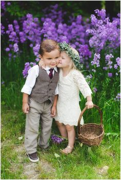 Young Romance between the flower girl and ring bearer! Adorable outfit inspiration for flower girl and ring bearer for a vintage wedding outdoors!