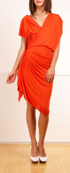 Orange Dress. model is way too skinny... you need curves for this dress!