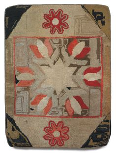 """Pennsylvania hooked rug with star and tulips Sold: $1,416.00 ($1,200) late 19th c. 42 ½"""" x 31 ¾""""Provenance: Antiques on Peaceable StreetLite..."""