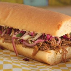 Slow-Cooked Cochon de Lait Po'Boy This is always a favorite at Jazz Fest. The tender pork melts in your mouth and the tangy coleslaw and Creole mayo are the perfect complements. It's time to break out that crock pot and make this delicious treat at home. Creole Recipes, Cajun Recipes, Cajun Food, Pork Recipes, Cajun Cooking, Louisiana Recipes, Entree Recipes, Slow Cooker Recipes, Crockpot Recipes